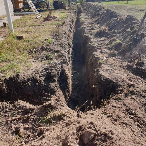 Közműárok kiemelés és csatorna ásás
